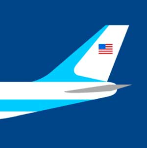 An airplane with the American flag on the tail of it