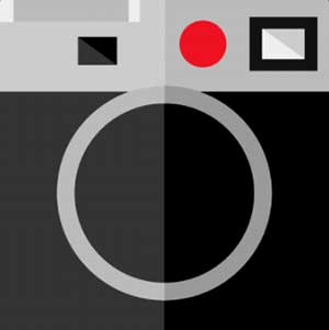 A grey and black camera with a red dot on it