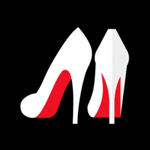 A pair of white heeled shoes with a red back to them