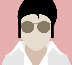 Man with black hair, white jacket, and sunglasses