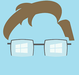 Man with brown hair and glasses with windows in them.