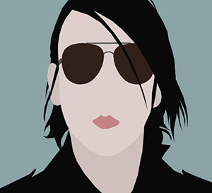 A man with long black hair and black sunglasses.