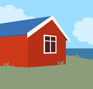 A red house with a blue rook on green grass