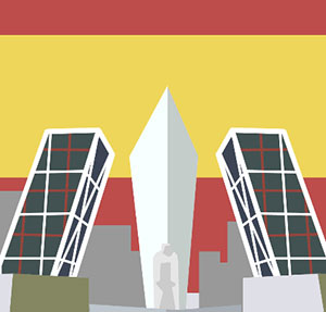 A red and yellow stripped flag in the background with two black and white building on the side, and a tall pointy white building in the middle