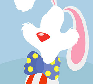 A white bunny with a blue and yellow pockadot tie and a red and white shirt