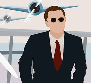 A man in a suit and tie in front of two airplanes
