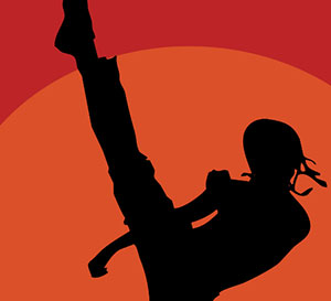 An orange background with a person kicking his leg up