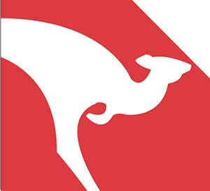 A white kangaroo in front of a red  background.
