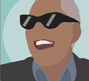 A black man with white teeth laughing wearing black sunglasses.