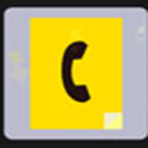 A yellow block with a black phone inside of it .